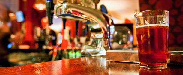 beer siting on restaurant bar