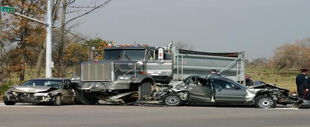 trucking accident involving dump truck and cars